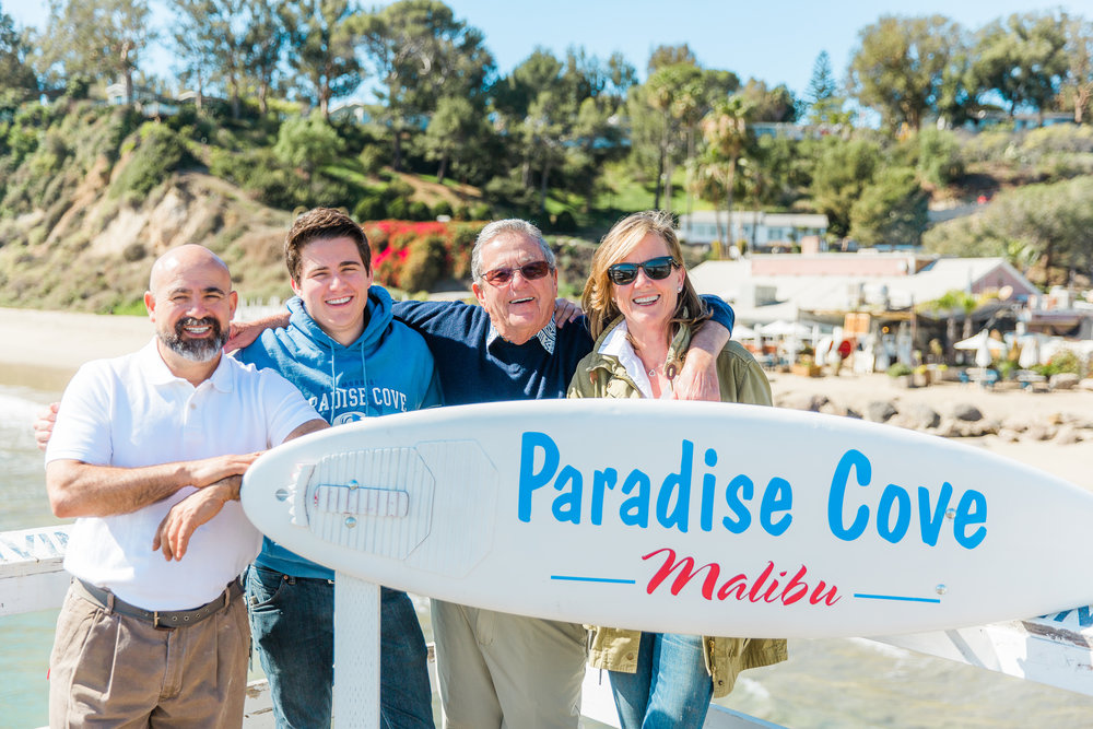 From left: Paradise Cove GM Pablo de la Torre, Timothy Morris, and owners Bob Morris and Kerry Morris.