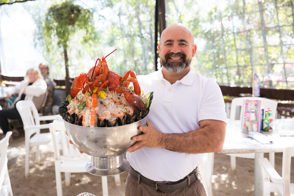 De la Torre with the restaurant's famous seafood tower.