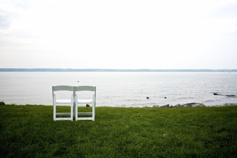 Two Empty Chairs by the Lake