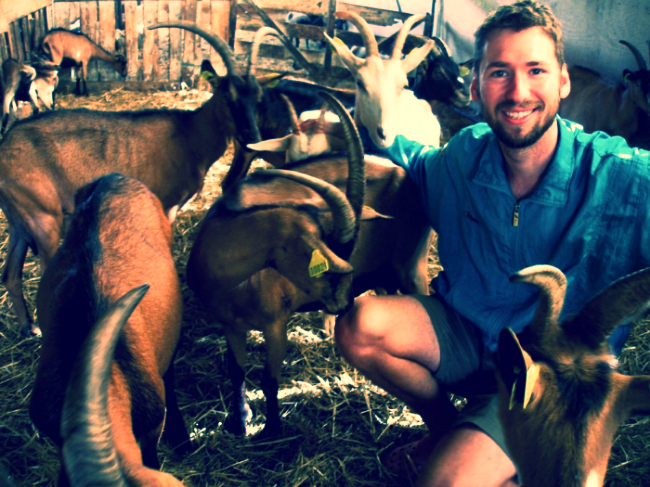 Hanging with some goats in my pre-postcard days.