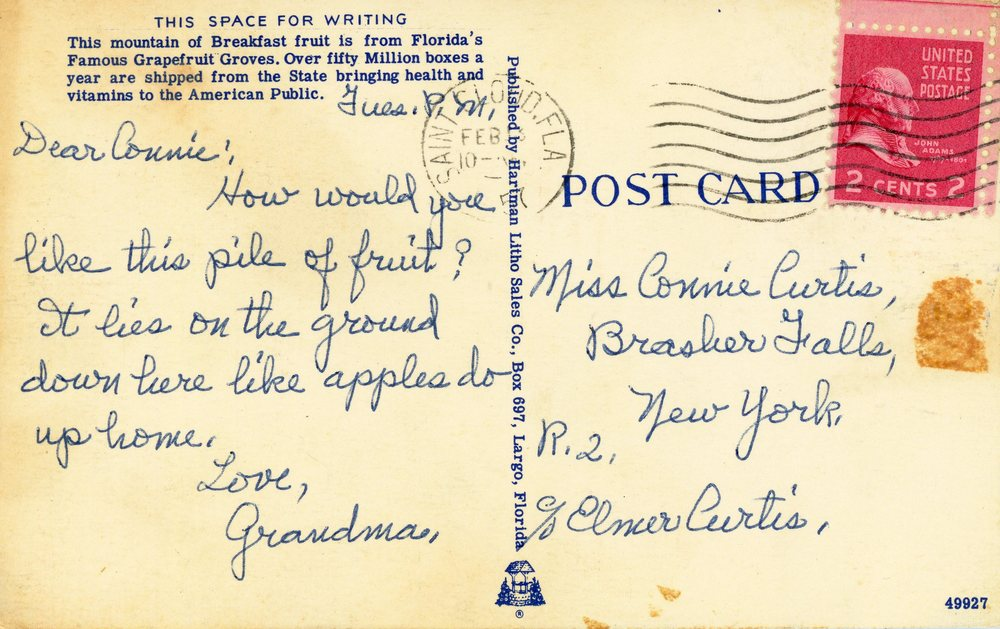 "Sent from Saint Cloud, FL, on February 13, 1957 to Brasher Falls, NY.  ""Dear Connie, How would you like this pile of fruit? It lies on the ground down here like apples do up home. Love, Grandma."""