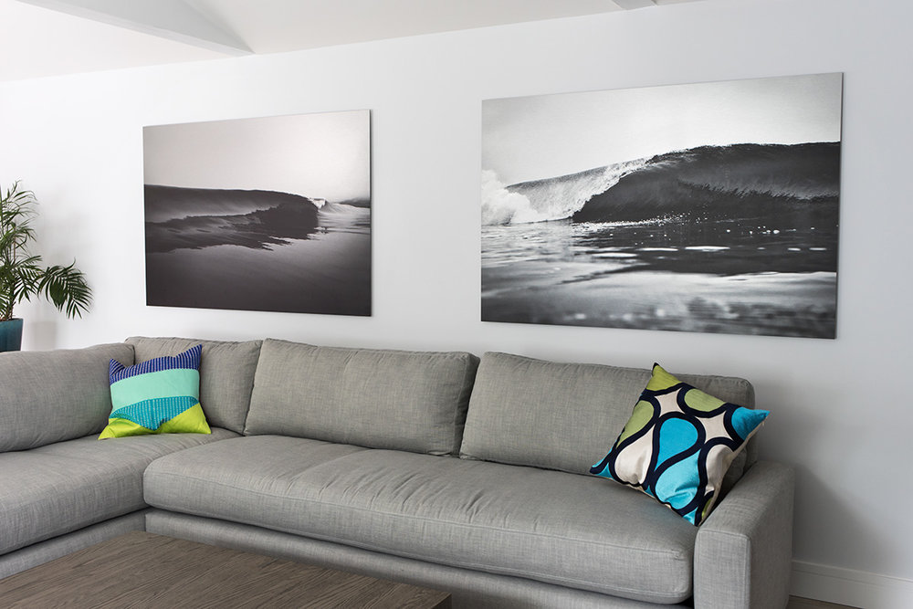 "I recently installed this pair of prints on brushed aluminum (""Grasp"" on the left and ""Smitten"" on the right) for the Stewart household in Walnut Creek.  It's intriguing how the highlights in the brushed aluminum reflect light back and seem to glow as the light changes throughout the day."