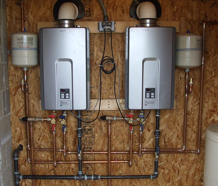 Two Tankless Hot Water Heaters working in parallel to provide enough hot water.