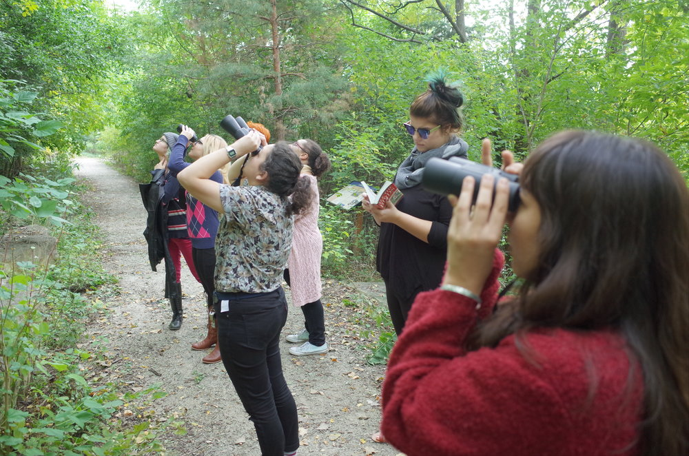 "Birdwatching at Lawrence University along the Fox River, part of ""Mass Migrations,"" photo by Ben Rinehart"