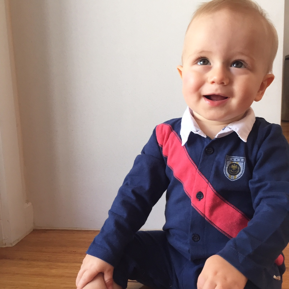 The Carter onesie - looks like he's posing for his first school photo!
