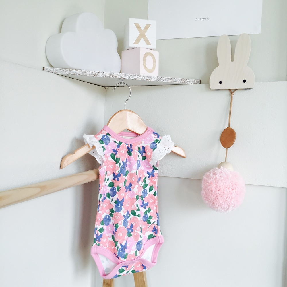 Jamie King for Sapling Child onesie from Little S and Co, Charlie and Jae hook and Luxe Baby Love giant pink pom