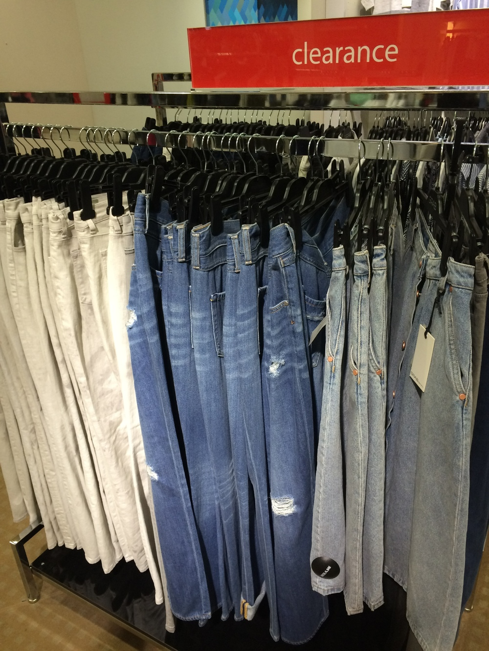 Racks of Denim and Shoes
