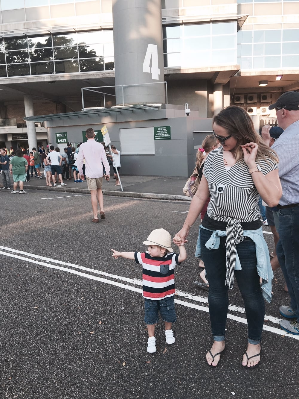 Arriving at the match -3 month old in our Elki baby carrier, 20 month old on the run!