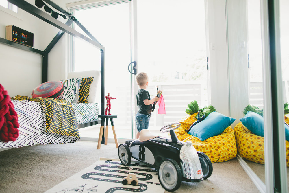 This Little Love bed, Sack Me linen and bean bag, Hip Kids racer, The Timbatrend stool, Oy Oy rug, Mitahli Designs wooden cars.