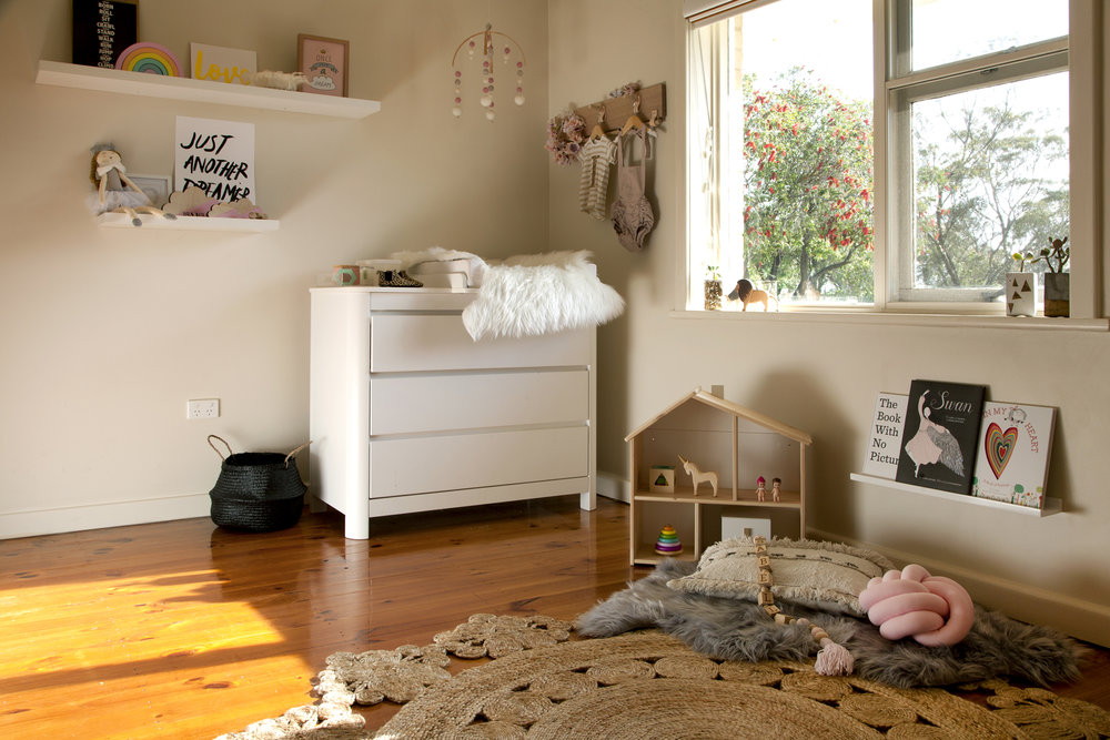 Create a reading nook to show off your children's beautiful books without breaking the bank. A shelf (purchased from Bunnings), a few cushions and you can really lift a blank space.