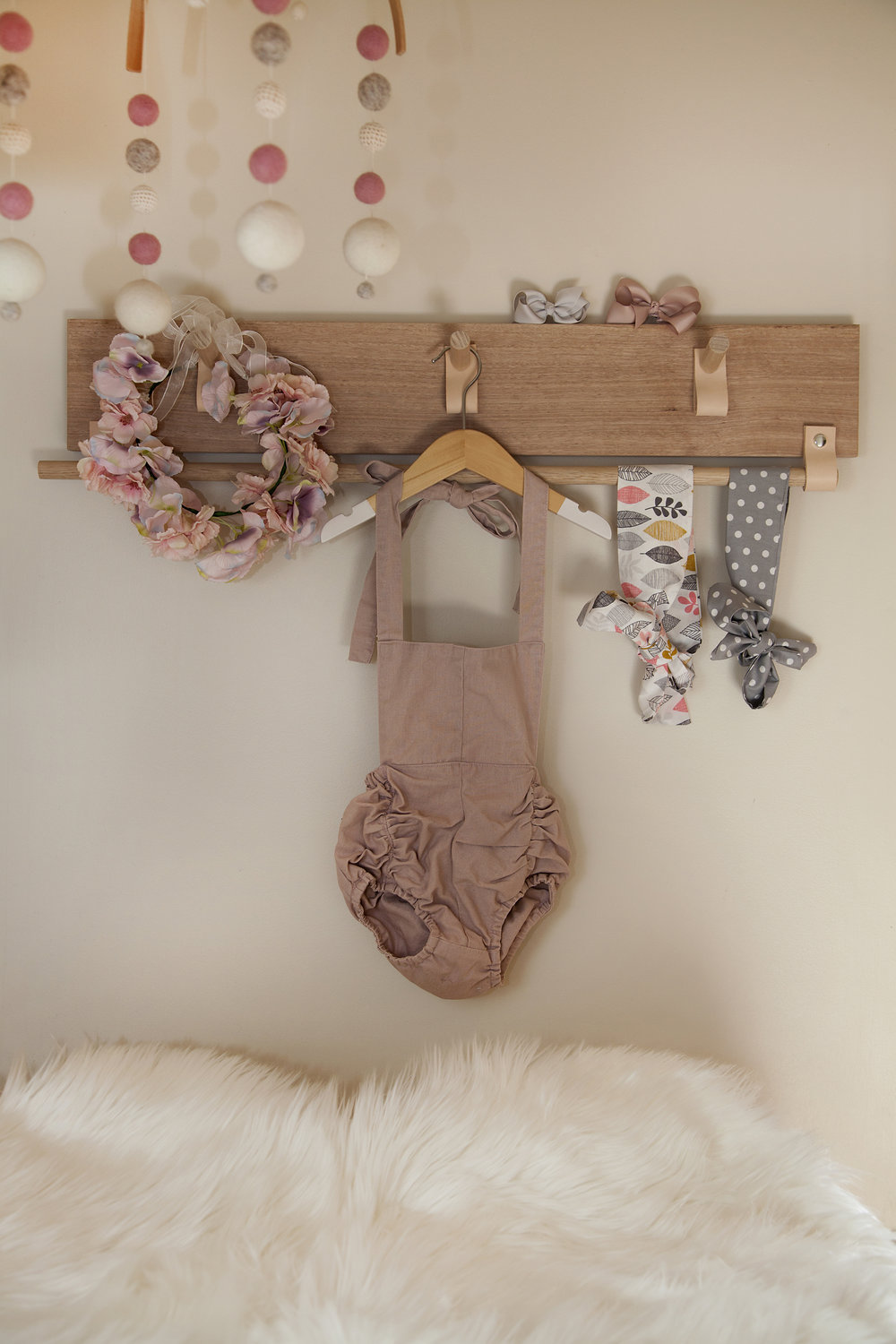 The perfect way to display her pretties. Accessory rack – Interior Motives Aus, Romper – Hubble and Duke, Head wraps – Lulu & Lo, Flower crown and bows – Branche
