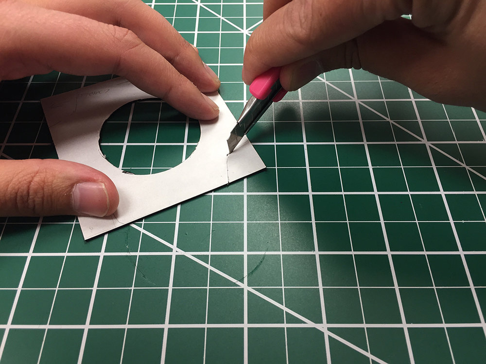 Use a safety blade to trim out the four marked corners