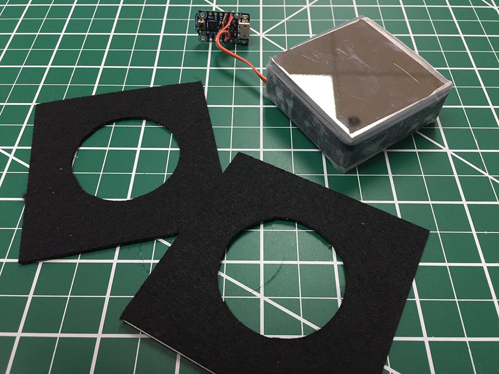 "Use the circle cutter to create a 1.75"" hold in both felt squares"