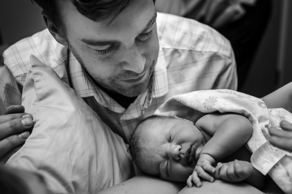 Dad-Admires-New-Baby