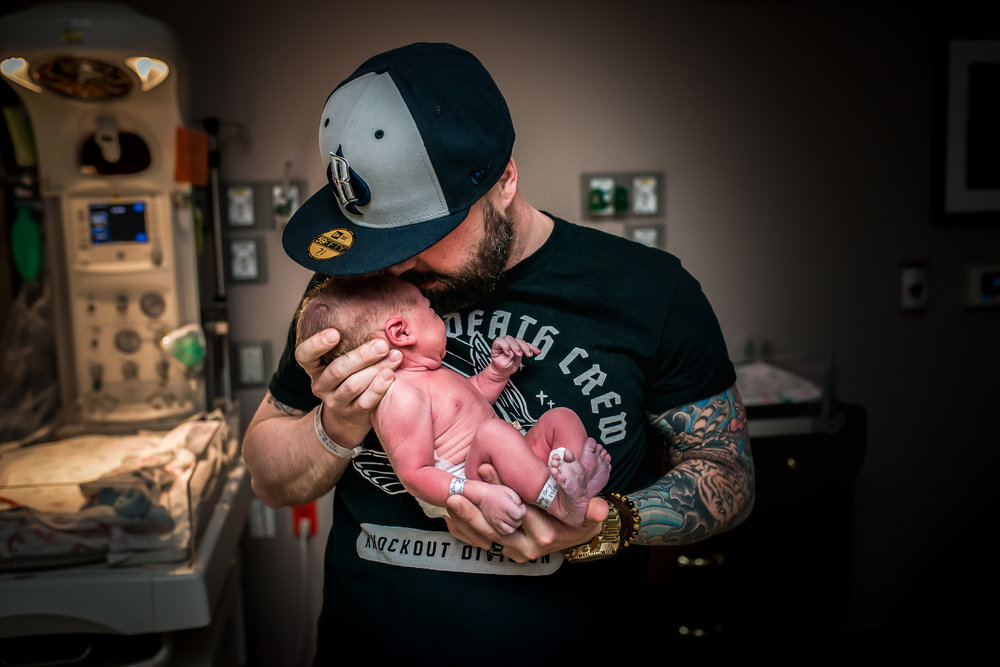 Fort-Collins-Birth-Story-Dad-Holds-Baby