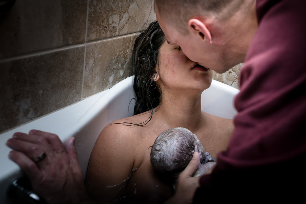 couple-embraces-denver-birth-photography
