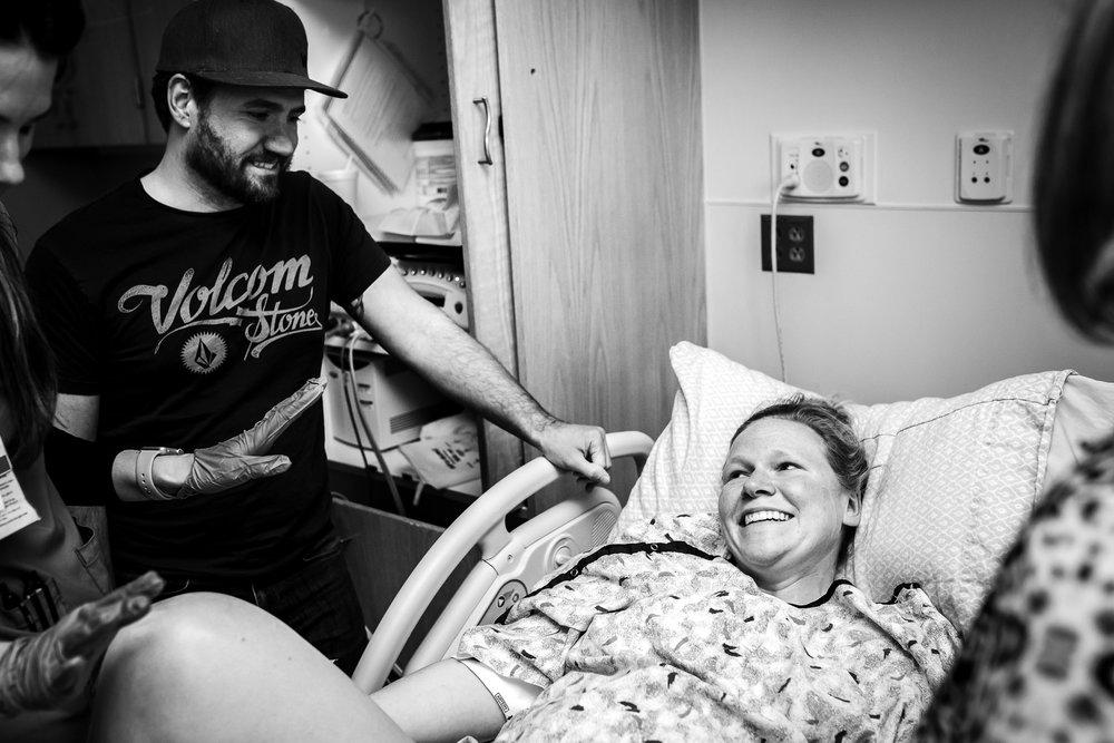 mom-laughing-pushing-denver-birth