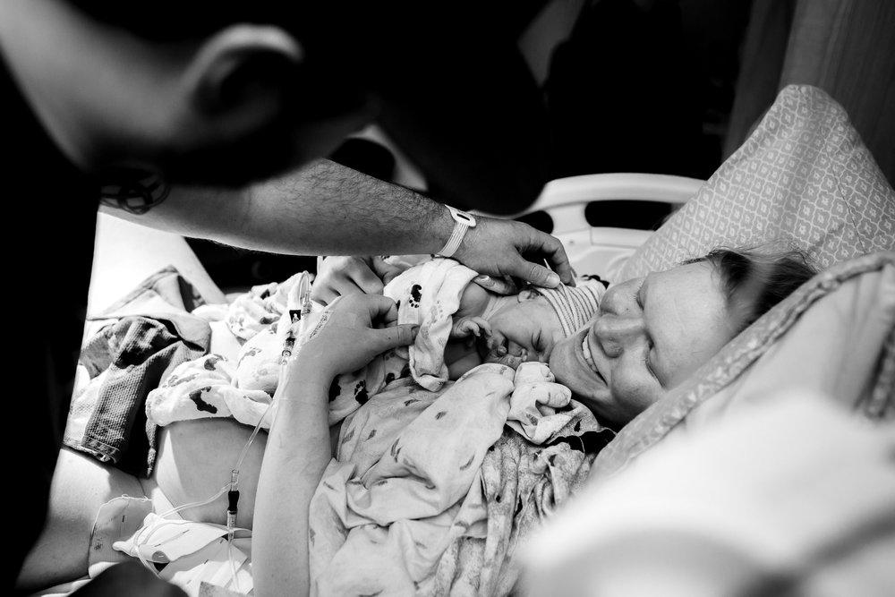 dad-admires-baby-denver-birth-photographer