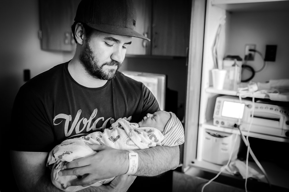 dad-holds-baby-denver-birth-photographer