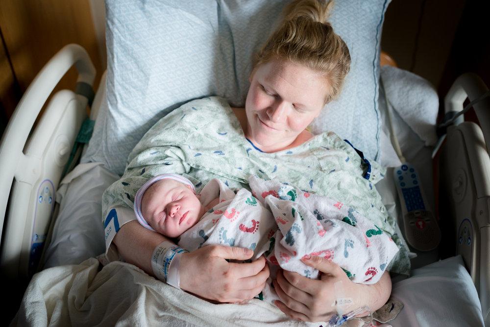 mom-holds-baby-denver-birth