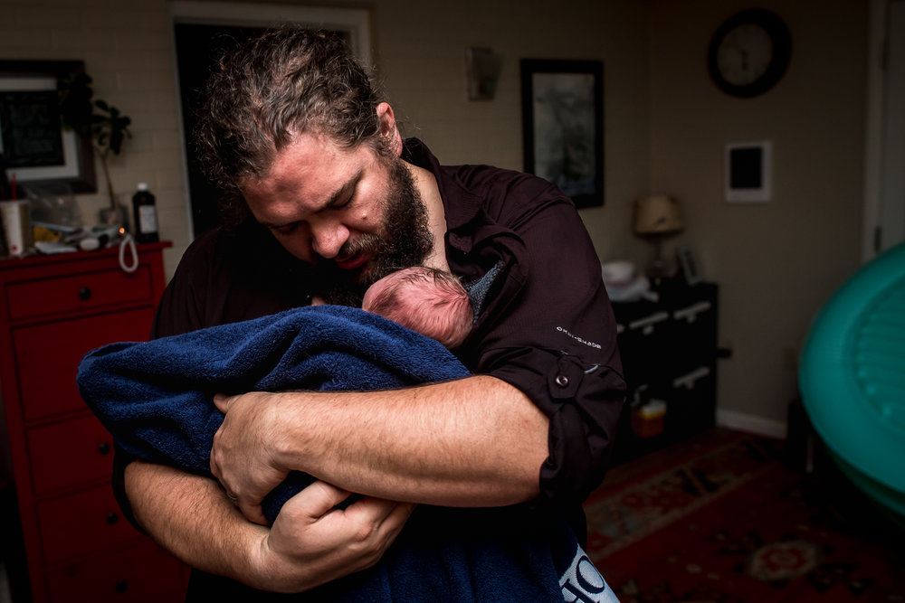dad holds baby