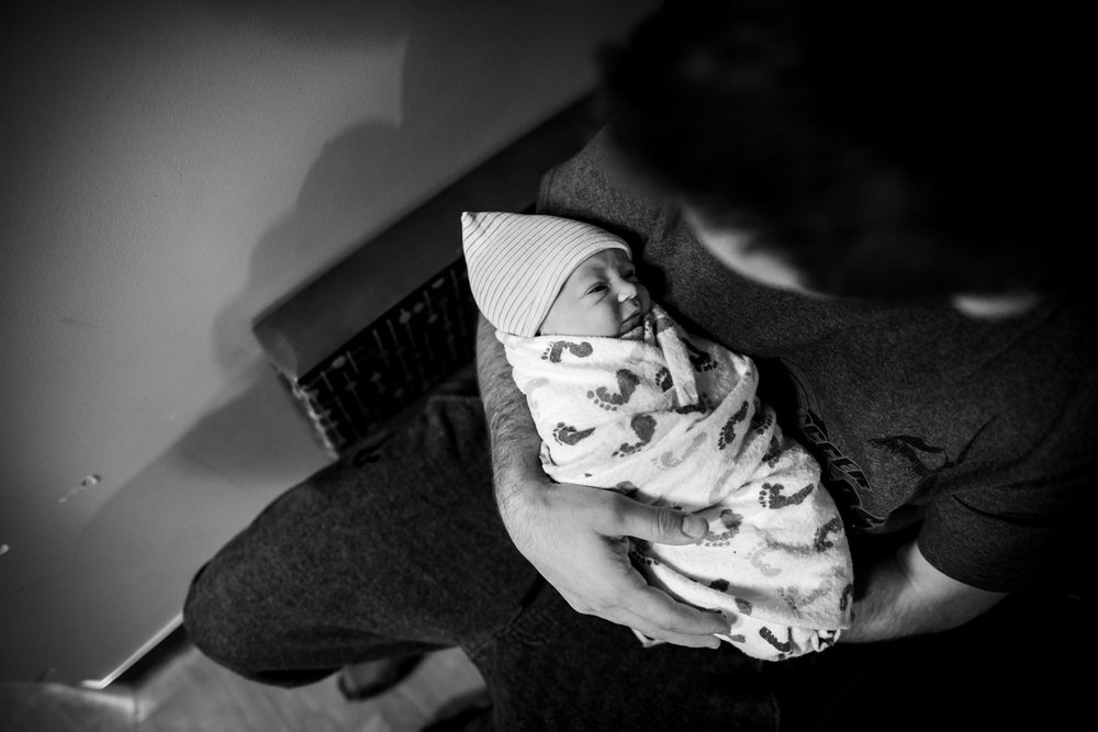 dad-holds-baby-in-recovery