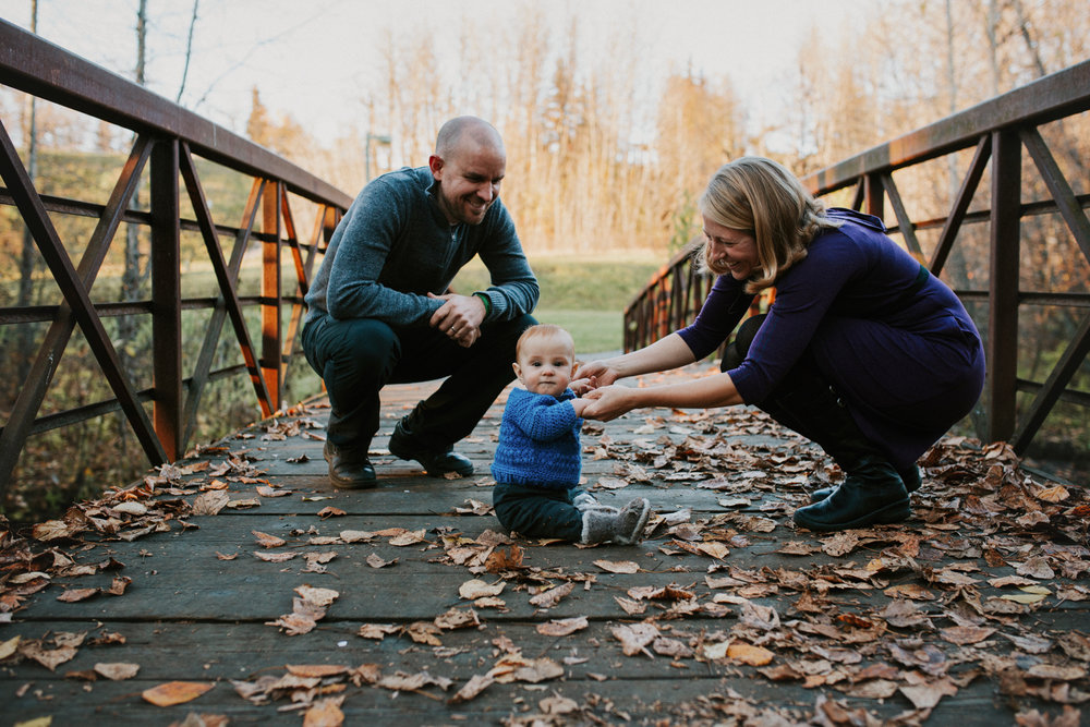 family on bridge with baby