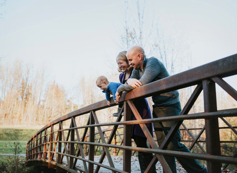 family on chester creek trail bridge