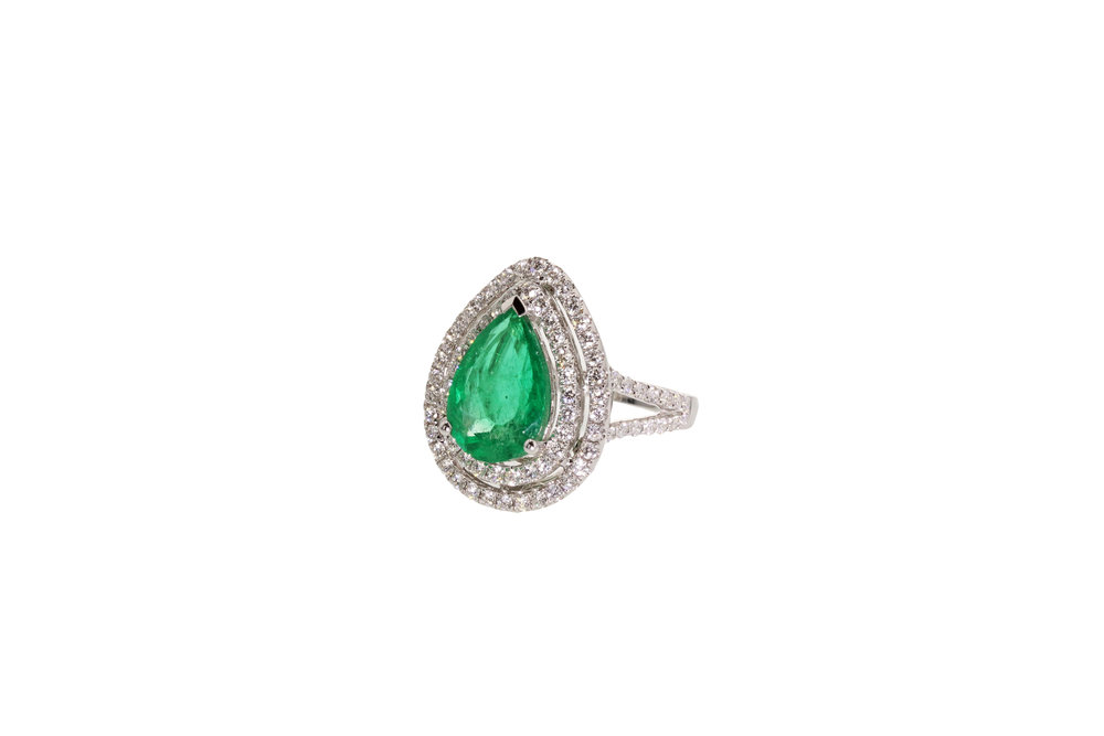 18kt White Gold Emerald and Diamond ring 3.05ct Emerald, 1.06ctw Diamonds.  $27,300