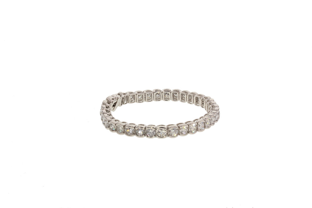 18KT White Gold Bezel Set Diamond Tennis Bracelet.  13 ctw.  $45,000