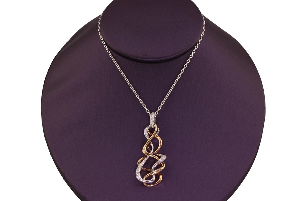 "18kt White and Rose Gold two-piece Diamond Pavé ""Double Twist"" Pendant and Chain. 0.30 ctw. $3900"