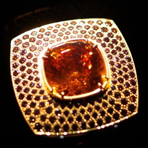 Mandarin Garnet  (39.35 carats) and (1.82 carats) of pave cognac diamonds 18k yellow gold diamond ring designed and created by Ernesto Moreira, Houston, Texas, U.S.A.