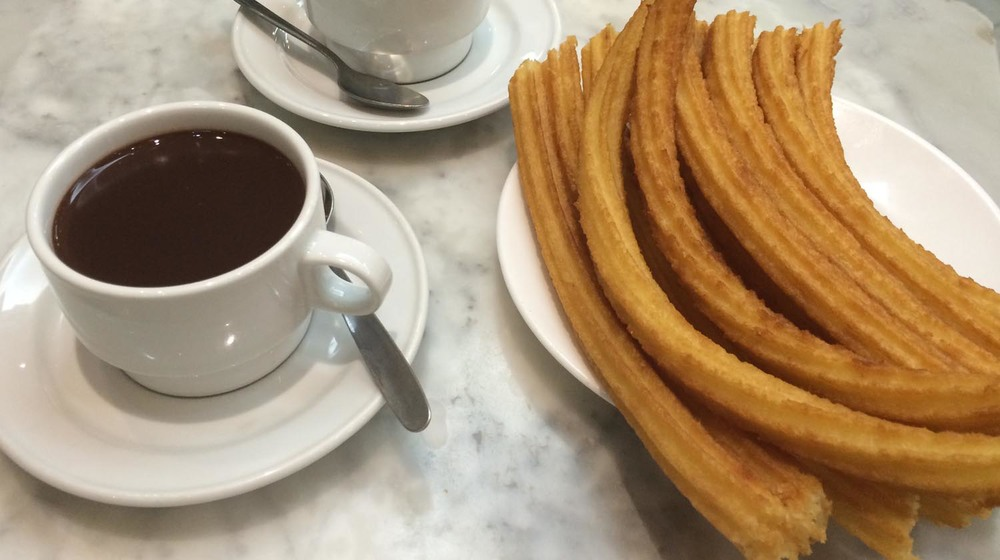Enjoy the hot chocolate at San Gines Chocolateria during our  Goya's Madrid Tour