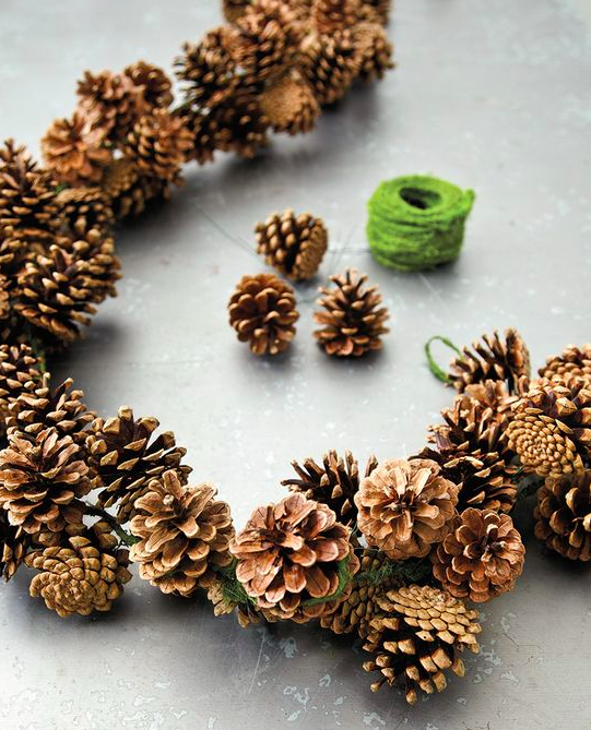 Collect a pile of pine cones and tie them up together to make a stunning wreath or garland. If you have time you can paint some of the edges with gold or silver metallic paint to give them some sparkle and less rustic.