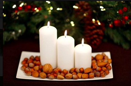 How easy is this? Church candles surrounded by a selection of nuts or lay them on a bed of cranberries. Simple and stylish.