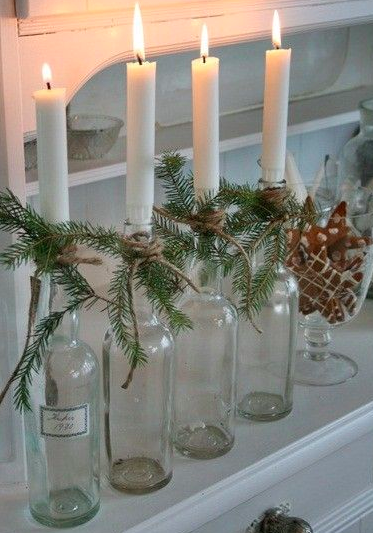 What a great way to recycle! Put some candlesticks into empty wine bottles with sprigs of spruce tied with twine, an array of them look gorgeous.