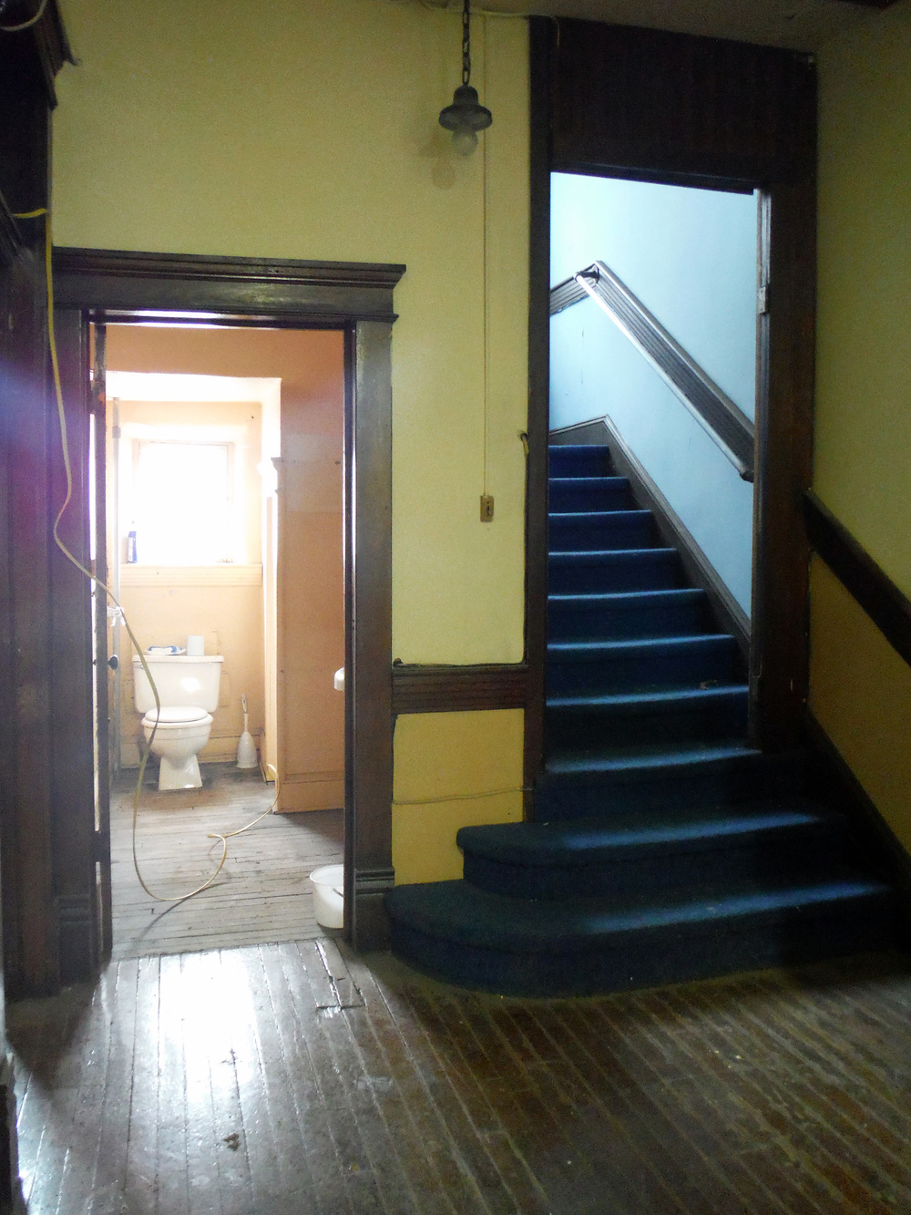 The second floor landing, with stairs leading up to the Masonic lodge.  Photo by Sydney Haltom, March 2015.