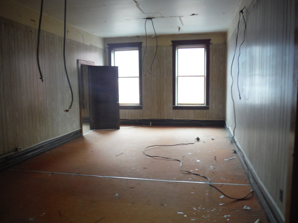 Another second floor office with wiring hanging down.  Photo by Sydney Haltom, March 2015.