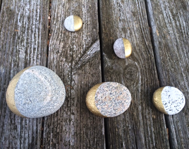 Gold paint + beach rocks + masking tape = pretty gold beach moon stones.