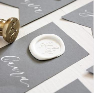 A white modern calligraphy place card wax seal from  Wax Seals