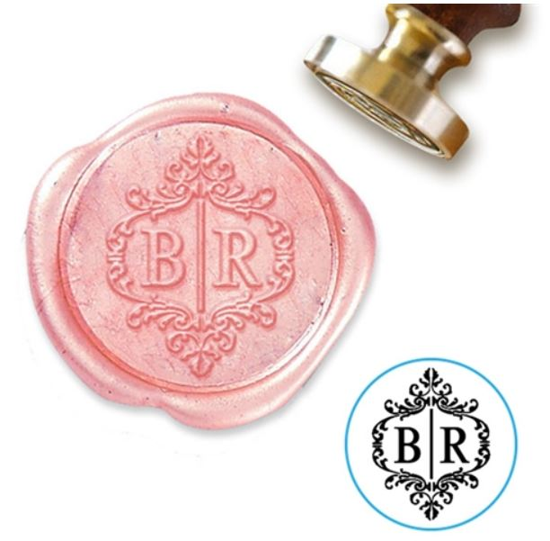 A blush pink wax seal from  Nostalgic Impressions.