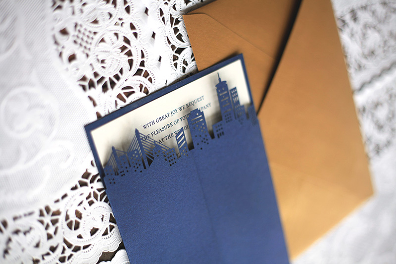 Our laser cut city skyline wedding invitation, featuring Boston, in navy blue metallic card stock.