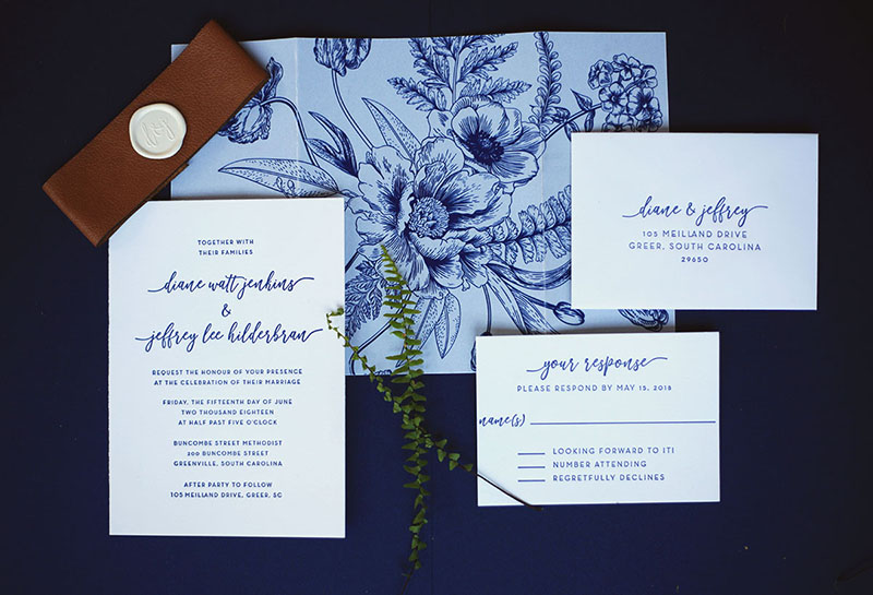 A client requested this modern navy letterpress wedding invitation featuring a beautiful floral vellum invitation wrap.