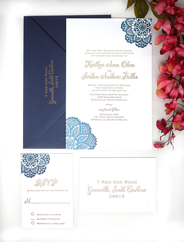 Navy is combined with antique gold in this letterpress wedding invitation suite.