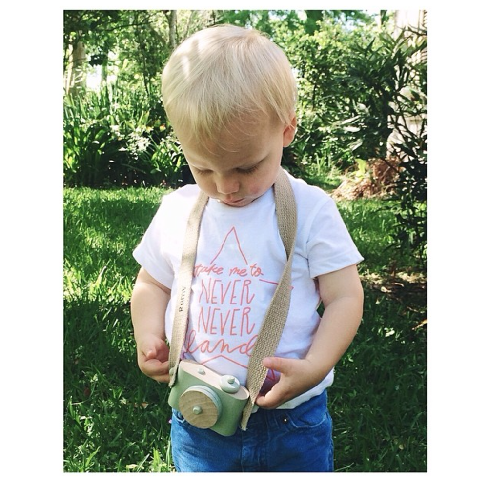 Remy playing with his camera in our Never Never Land Infant Tee