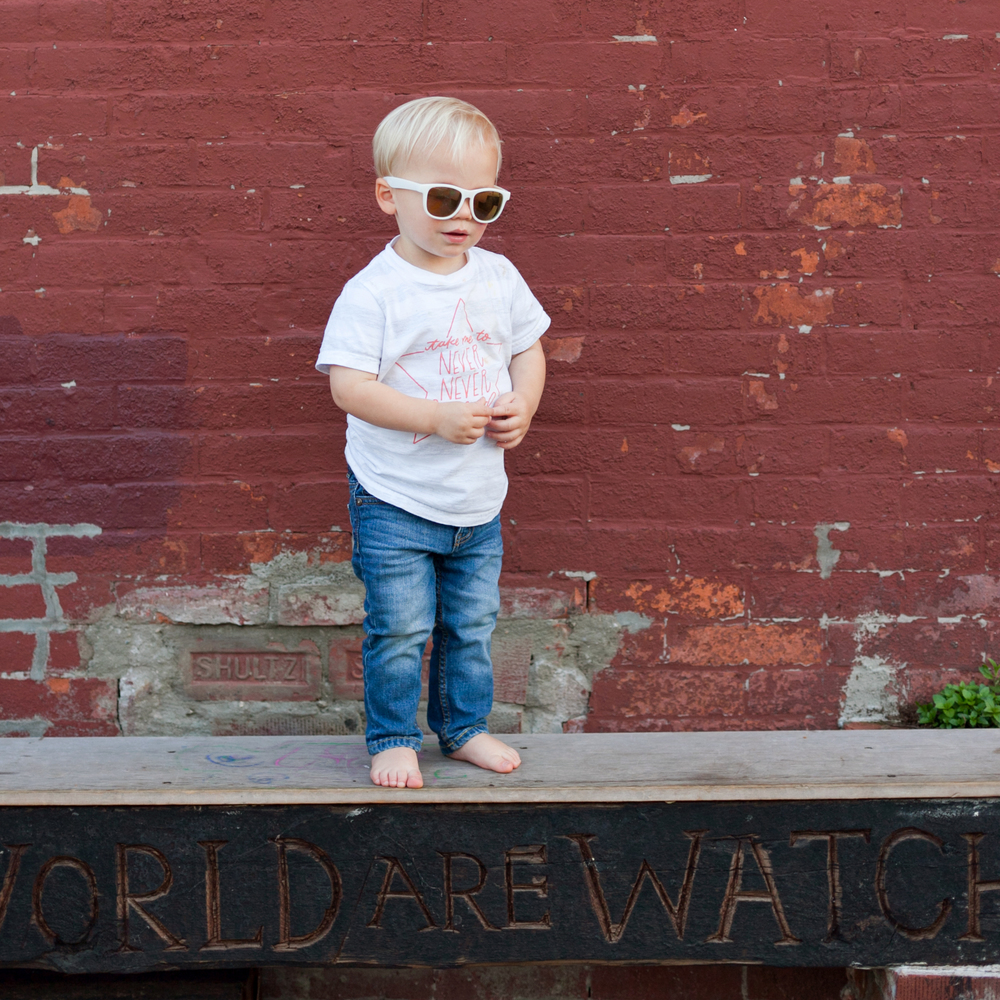 looking cool in Red Hook, Brooklyn in our Never Never Land Kid's Tee
