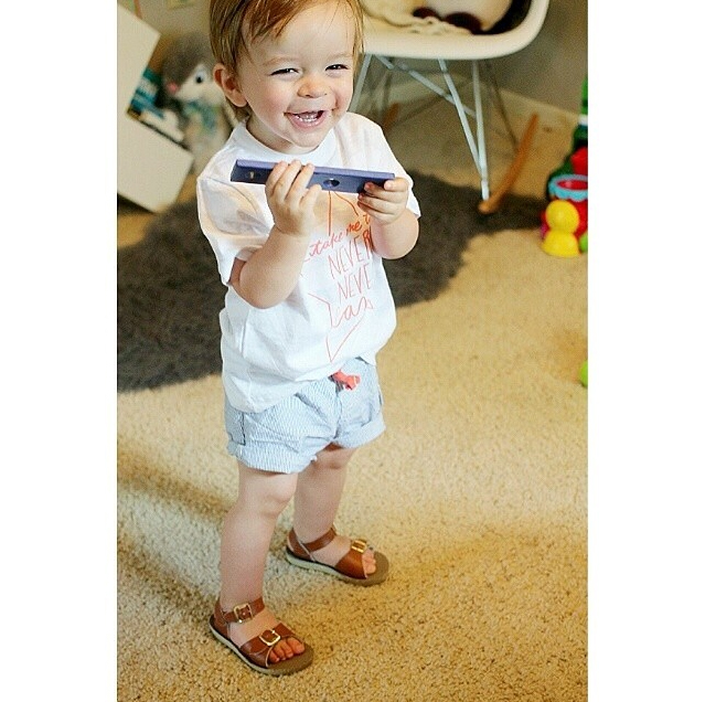 @brittanycomeaux's little guy having fun in our Never Never Land Infant Tee