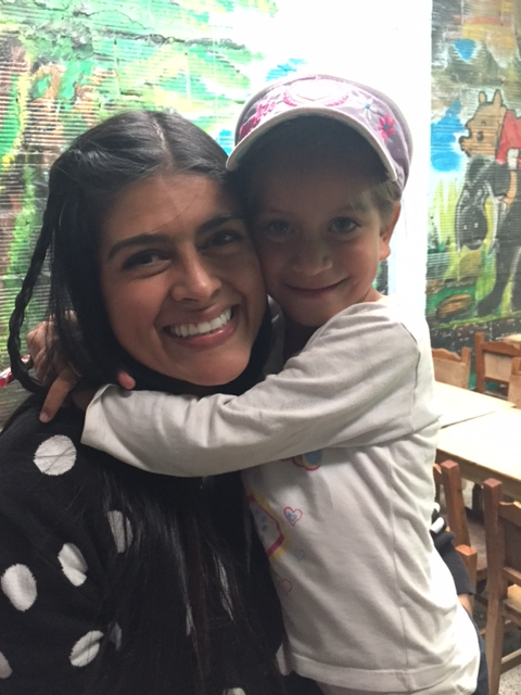 Beautiful Mafe (a volunteer from Vida Bogota) and the little girl who has stolen her heart.