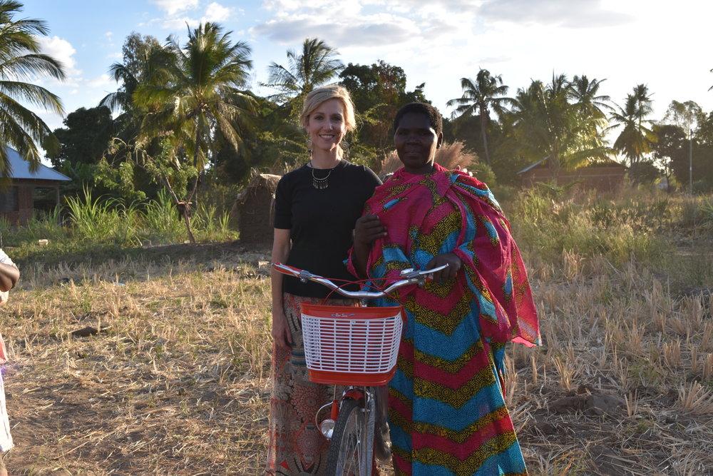 Pastor Elizabeth receiving her bicycle