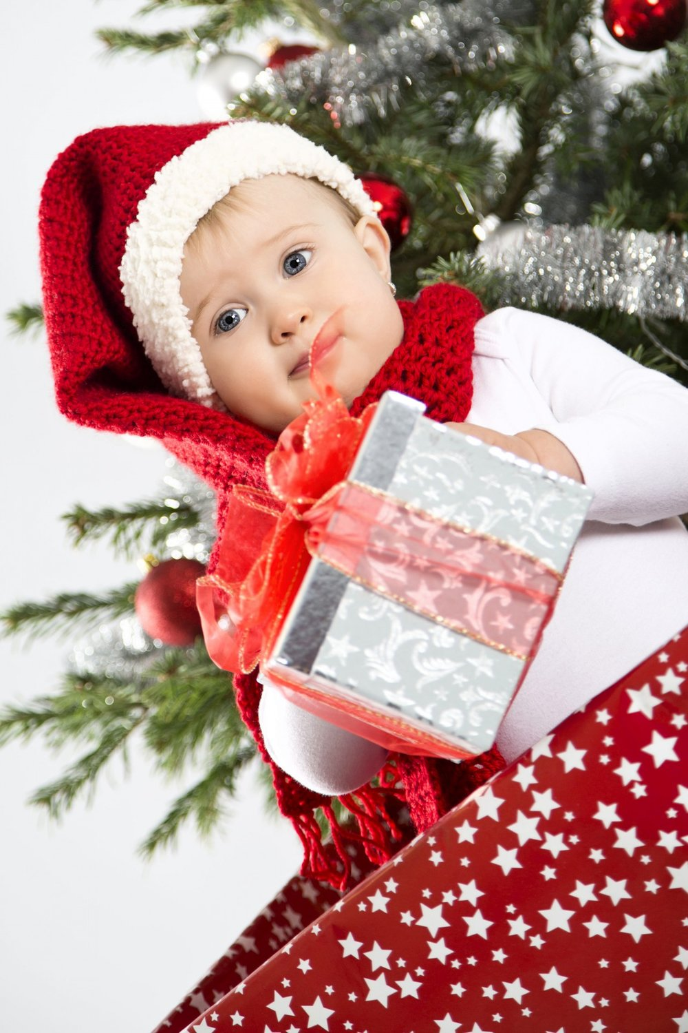 Baby with a Christmas present